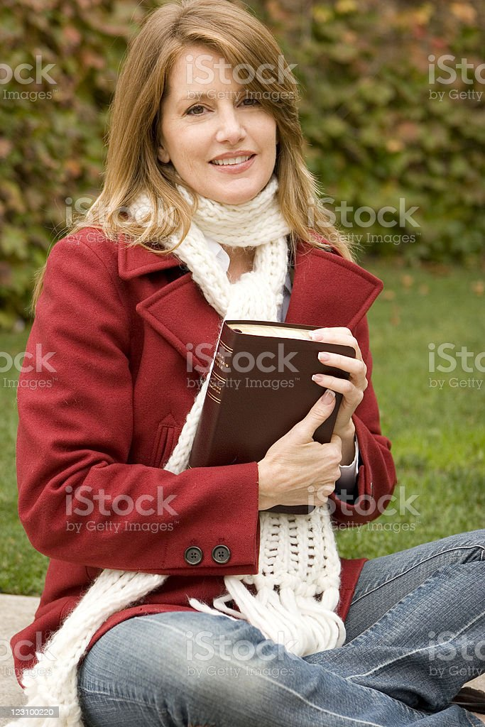 Woman holing a book royalty-free stock photo