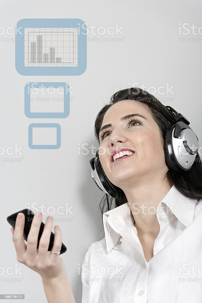 Woman holing out phone displaying volume royalty-free stock photo