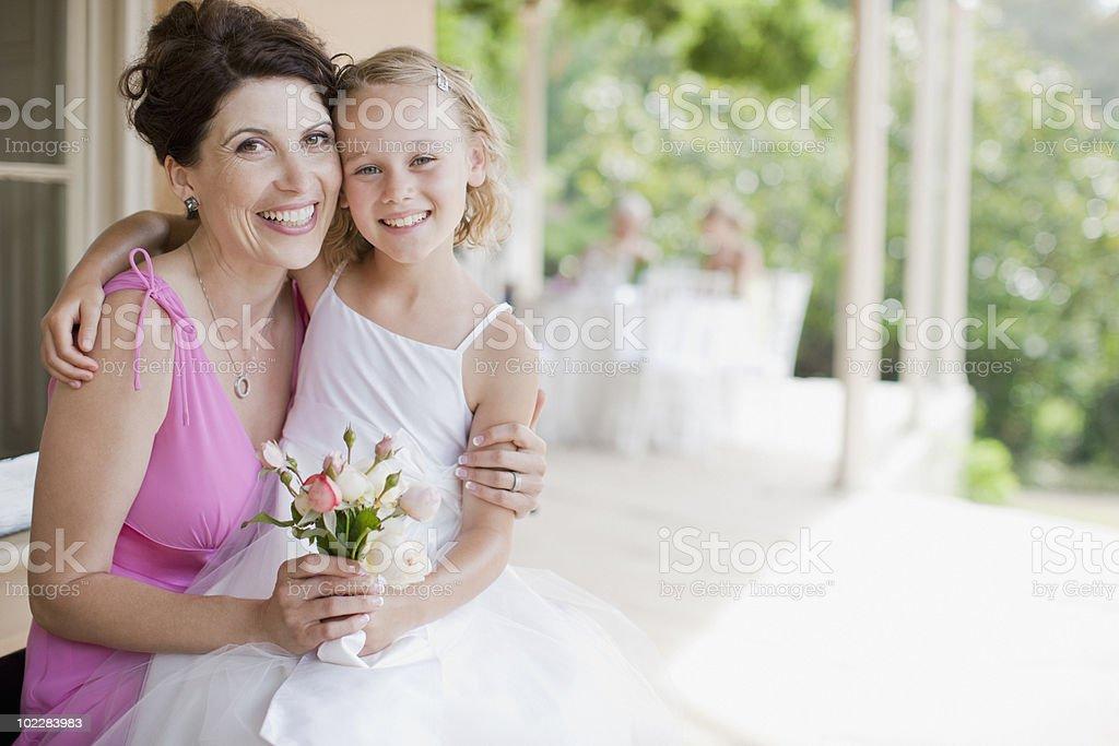Woman hugging flower girl royalty-free stock photo
