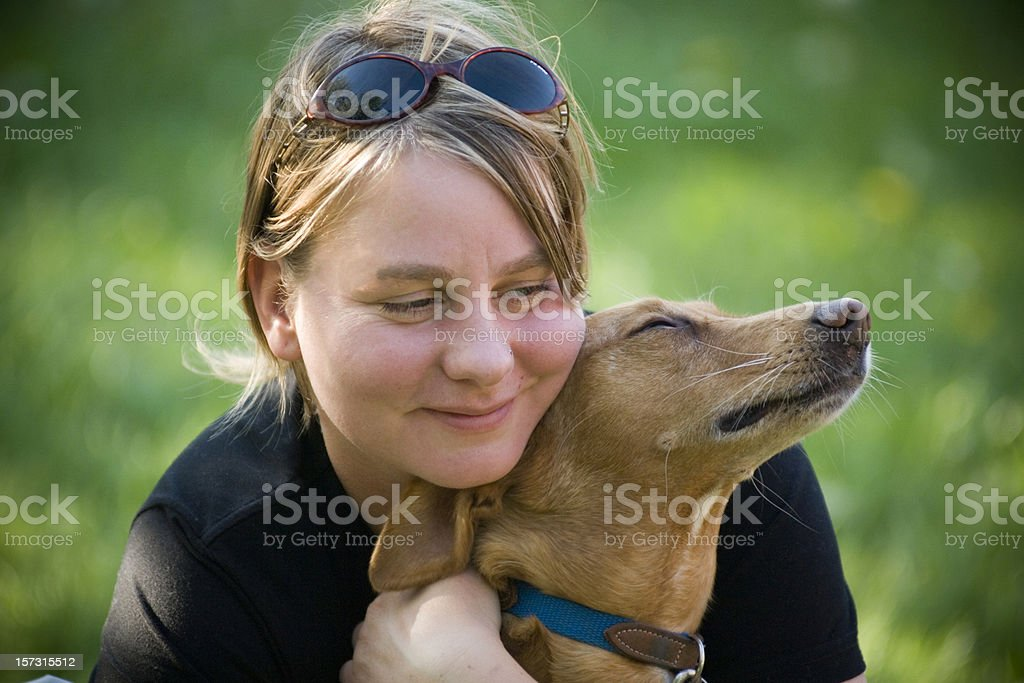 Woman hugging her dog royalty-free stock photo