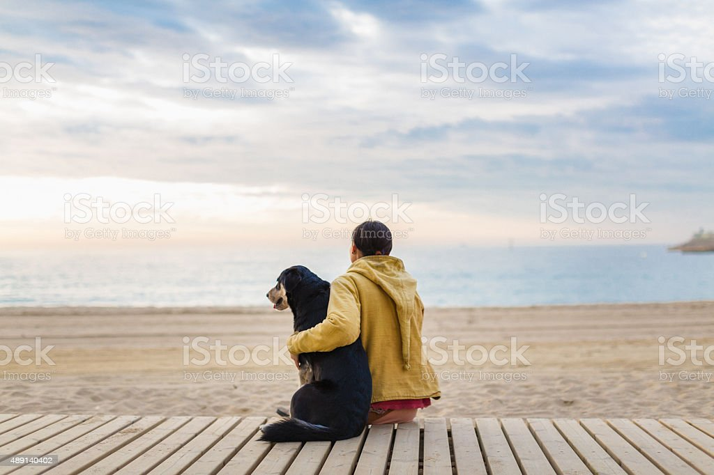 Woman hugging her dog stock photo