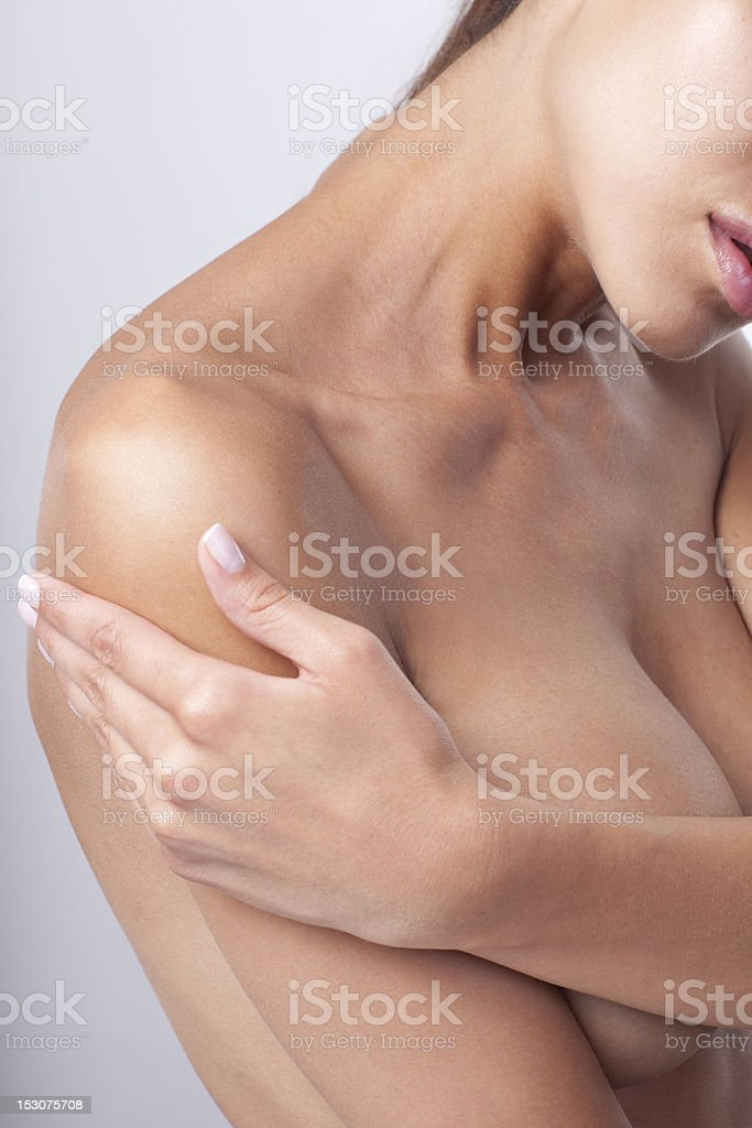 Woman hugging her own body with white background royalty-free stock photo