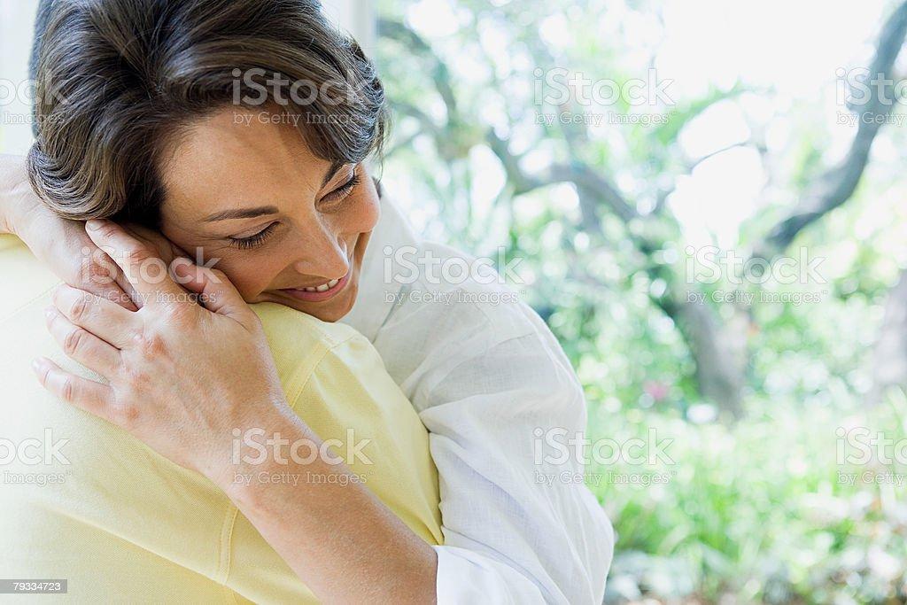 Woman hugging stock photo