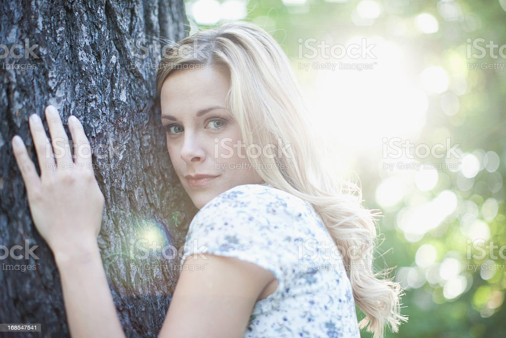 Woman hugging tree outdoors royalty-free stock photo
