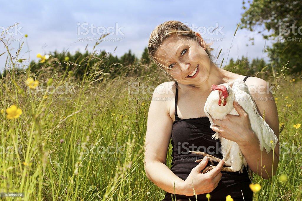 woman hugs an white chicken, horizontal stock photo