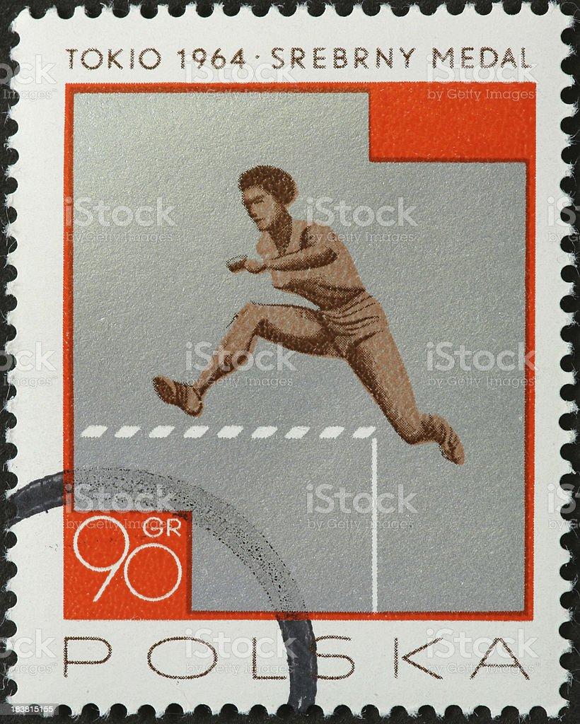woman hurdler on an old Polish stamp royalty-free stock photo