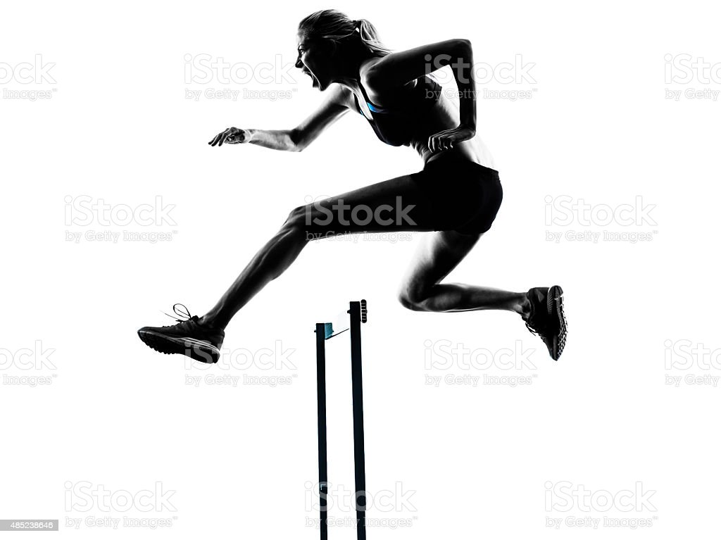 woman hurdlers  hurdling  silhouette stock photo