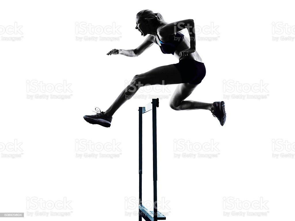woman hurdlers  hurdling  silhouette stock photo