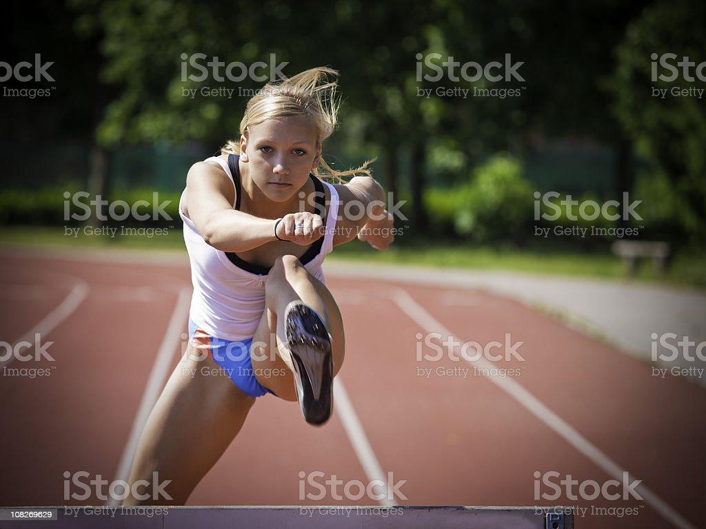 Woman Hurdling royalty-free stock photo