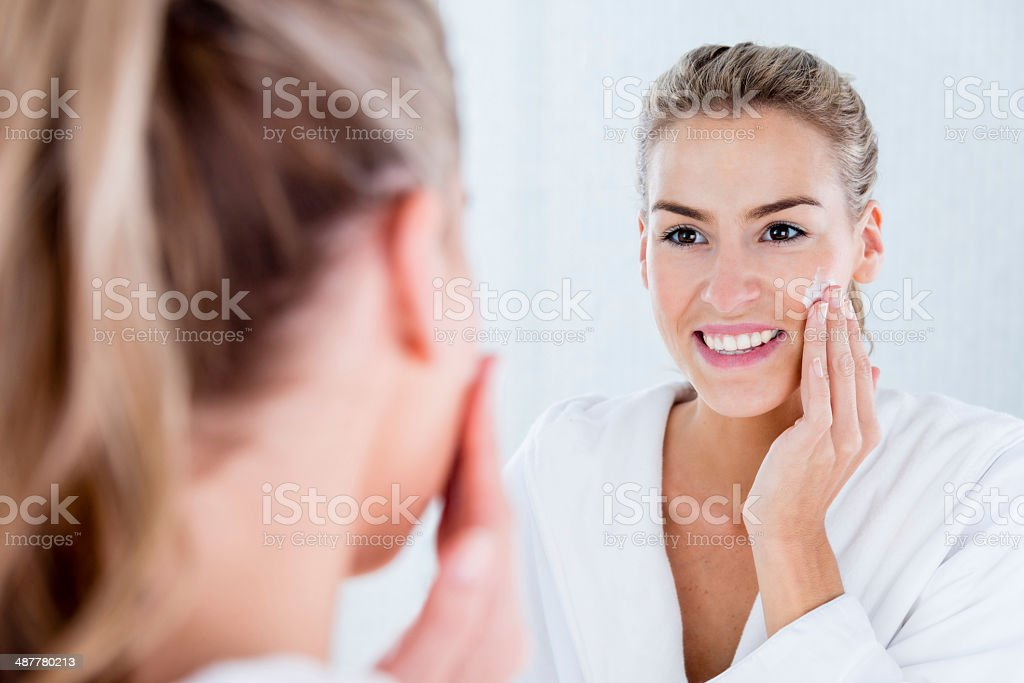 Woman hydrating her skin stock photo