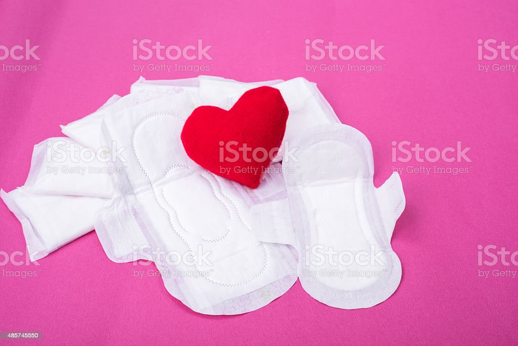 Woman hygiene protection (sanitary) on paper background stock photo