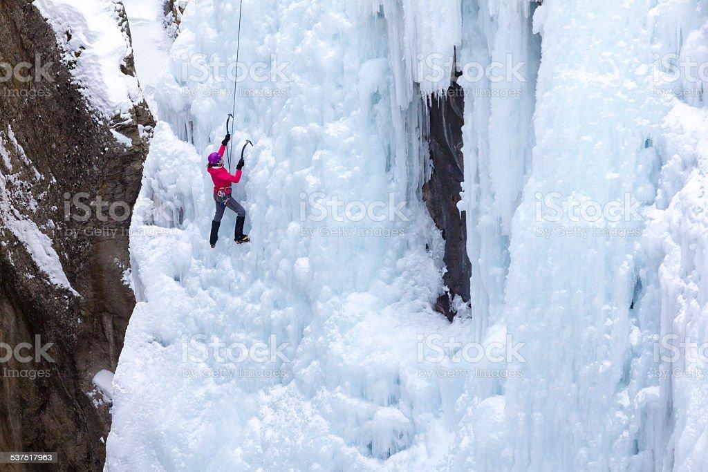 Woman Ice climbing stock photo