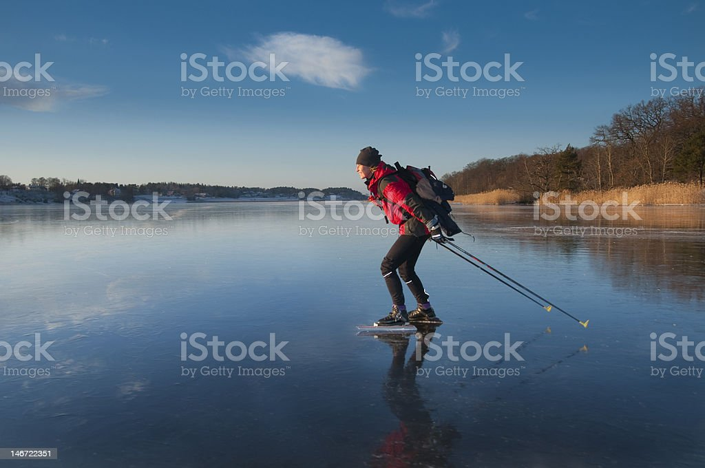 Woman ice skating on lake in Sweden stock photo