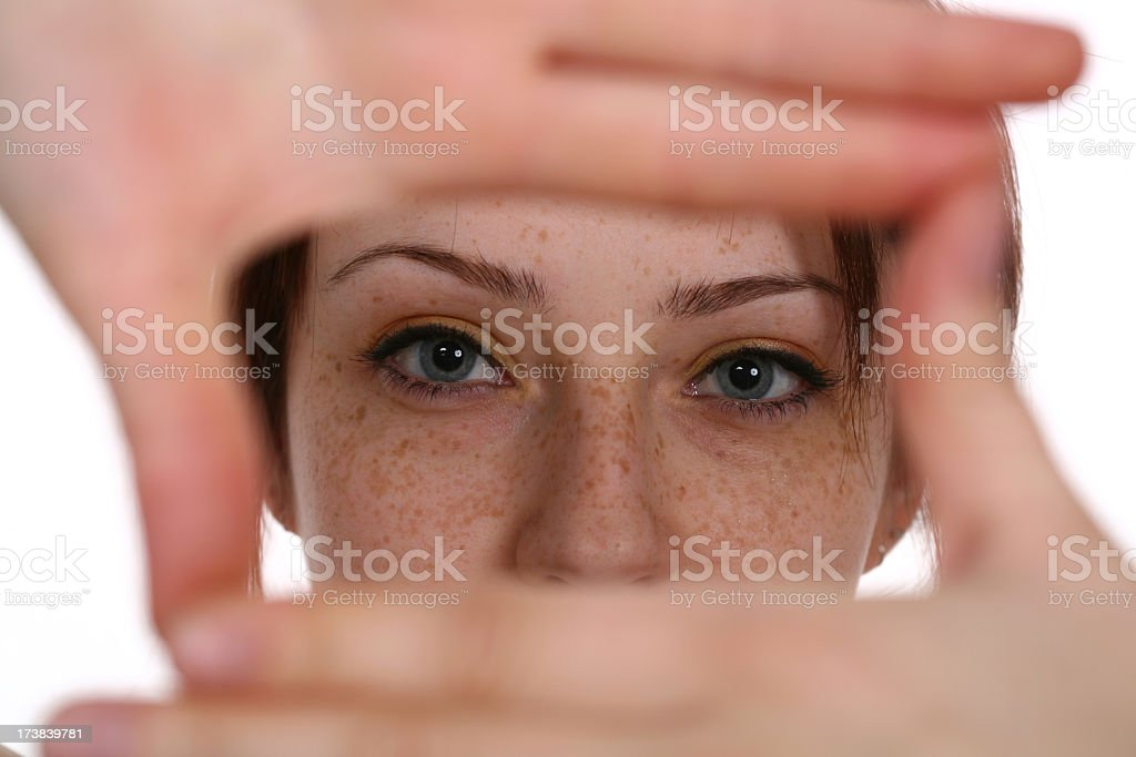 Woman imaging with her hands in the shape of a square stock photo