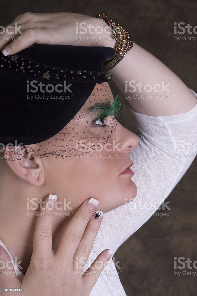 Woman in 40s style hat, side view. royalty-free stock photo