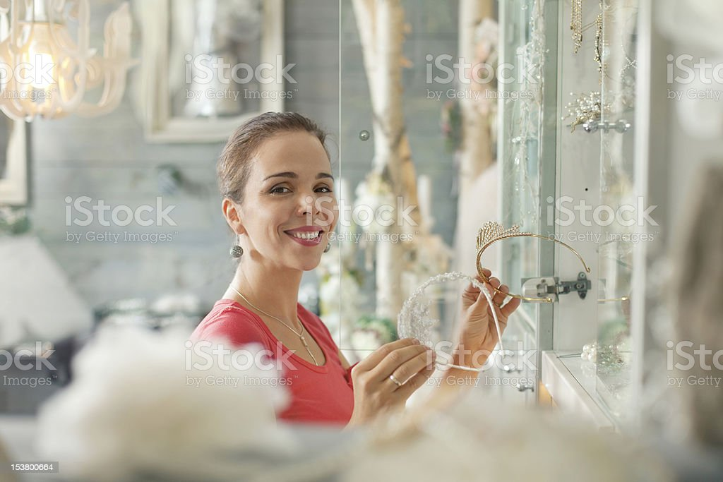 Woman in a accessory boutique royalty-free stock photo