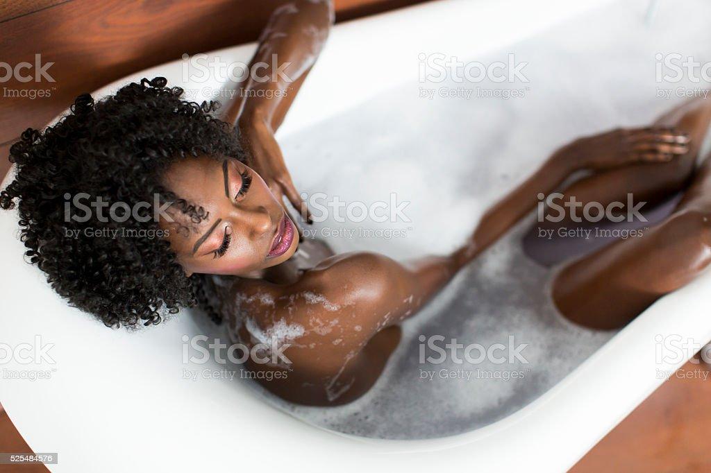 Woman in a bathtub stock photo