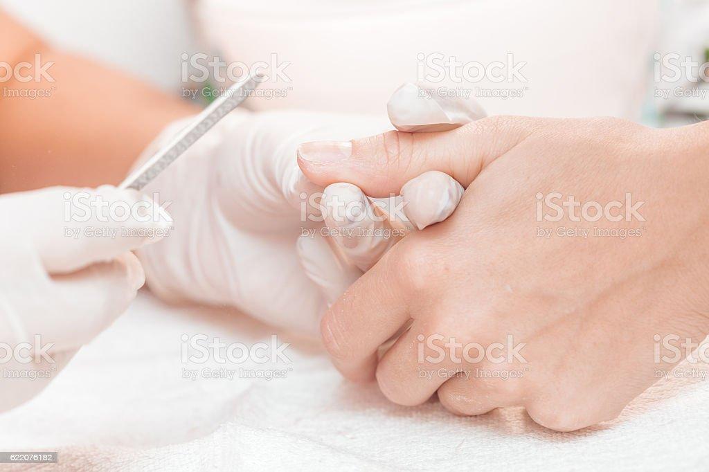 woman in a beauty salon receiving  manicure stock photo