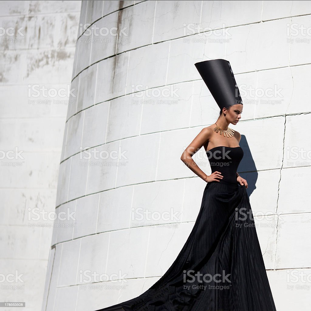 A woman in a black dress and a Nefertiti style headdress  stock photo