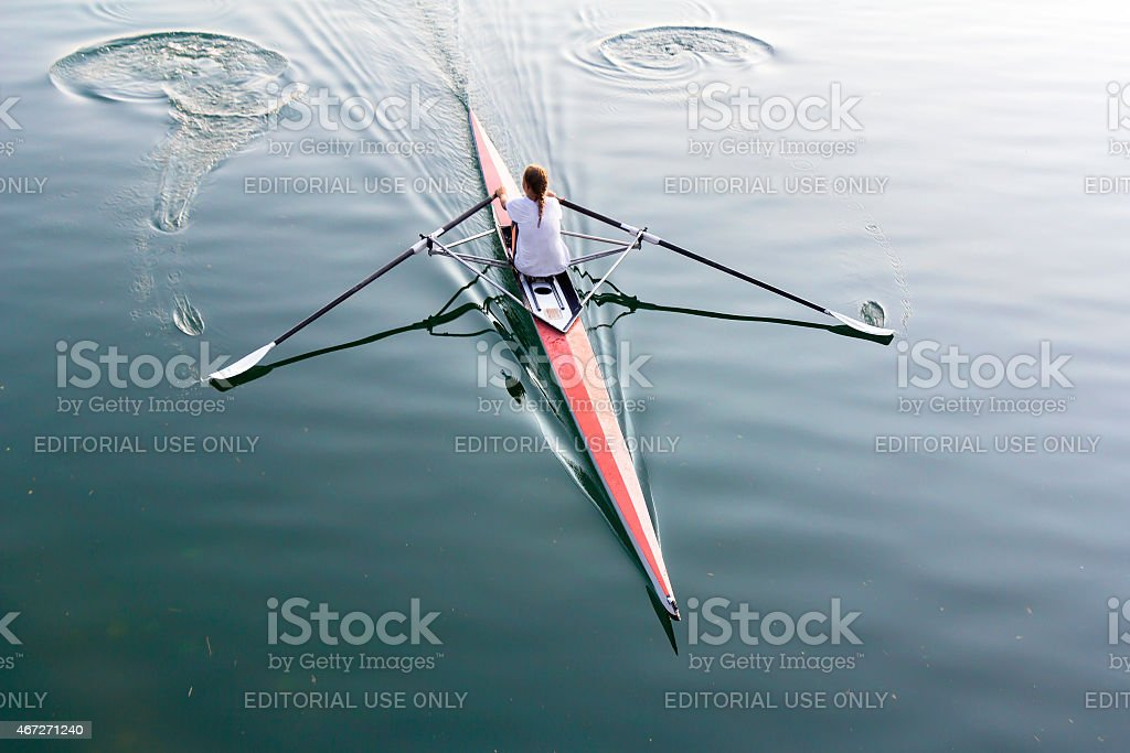 Woman in a boat stock photo