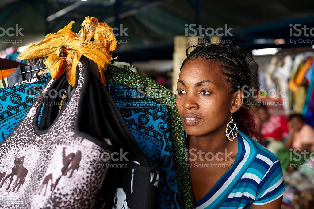 Woman in a bright African market stock photo