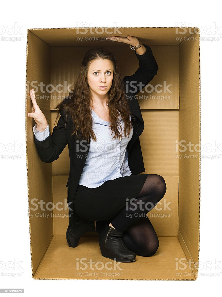Woman in a Carboard Box royalty-free stock photo