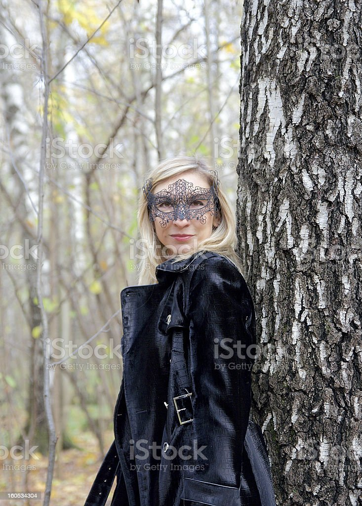 woman in a carnival half-mask royalty-free stock photo