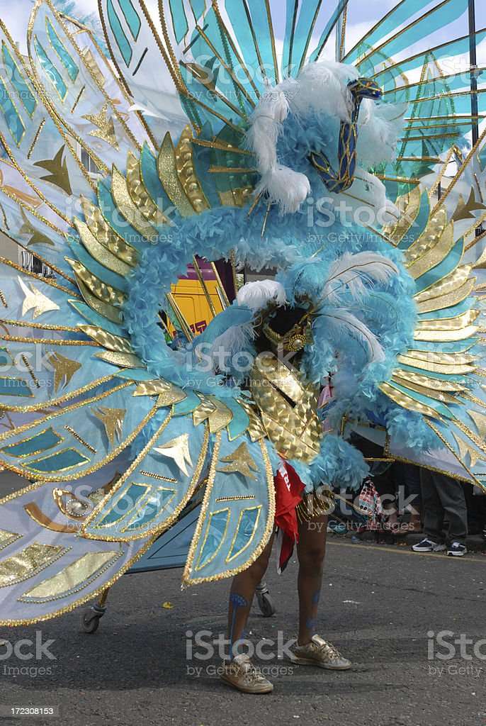 Woman in a carnival parade as a blue peacock  stock photo