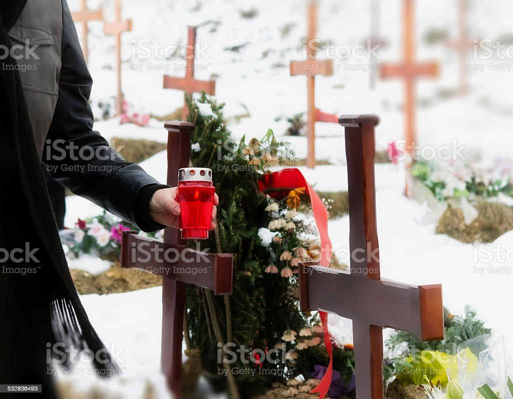 Woman in a cemetery stock photo