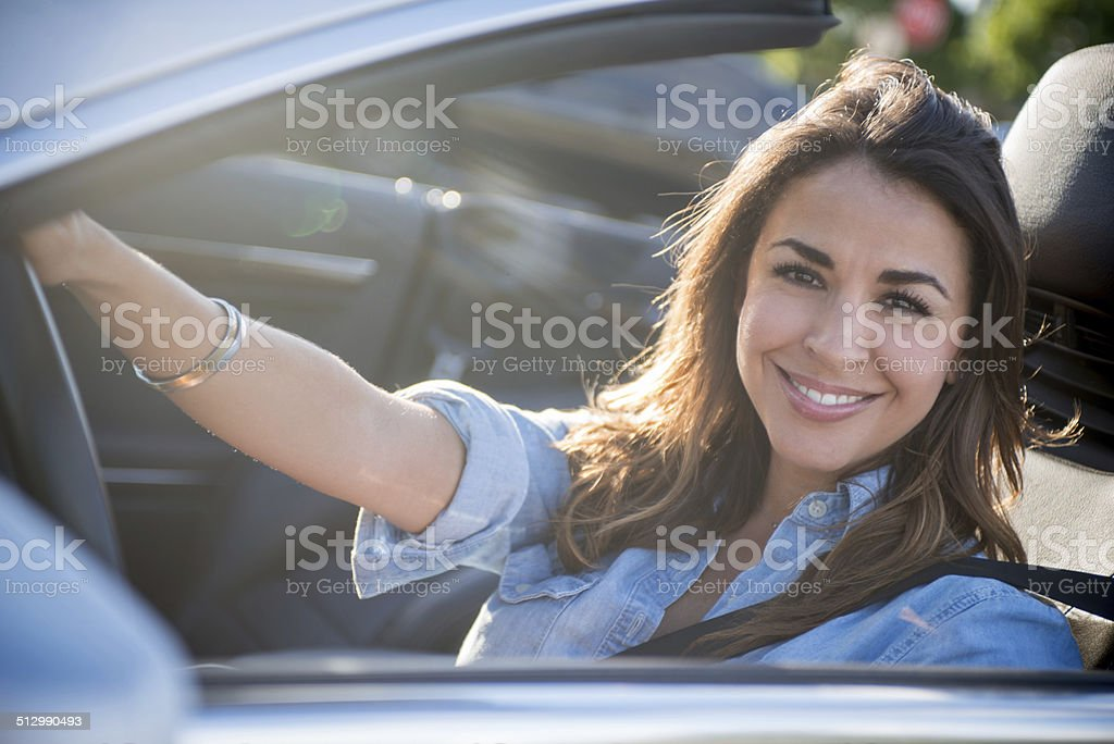 Woman in a convertible stock photo