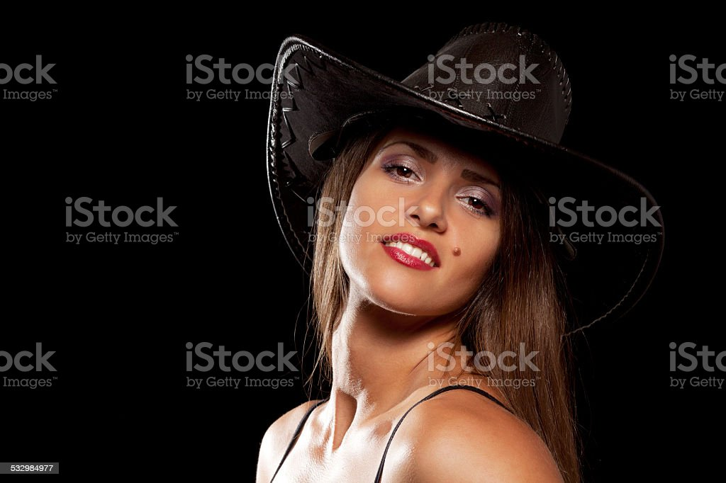 Woman in a cowboy hat stock photo