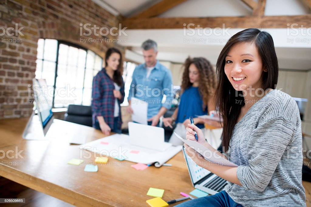 Woman in a creative office stock photo