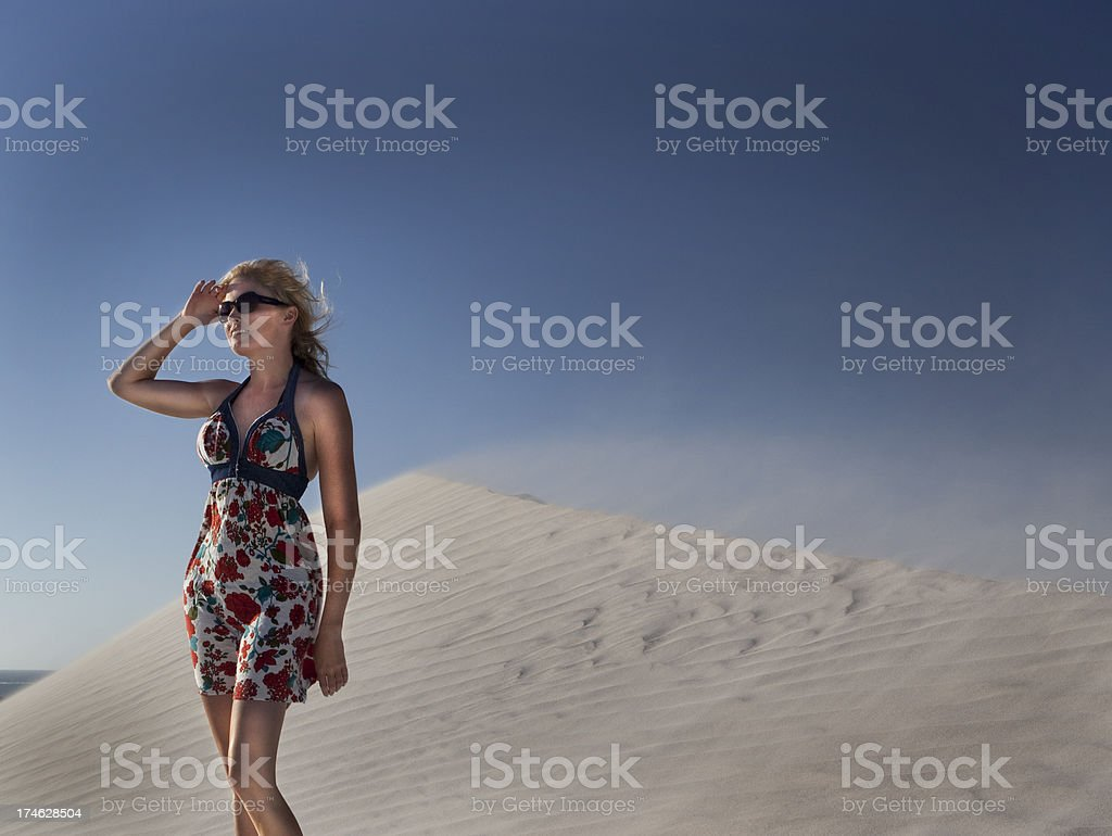 Woman in a desert royalty-free stock photo