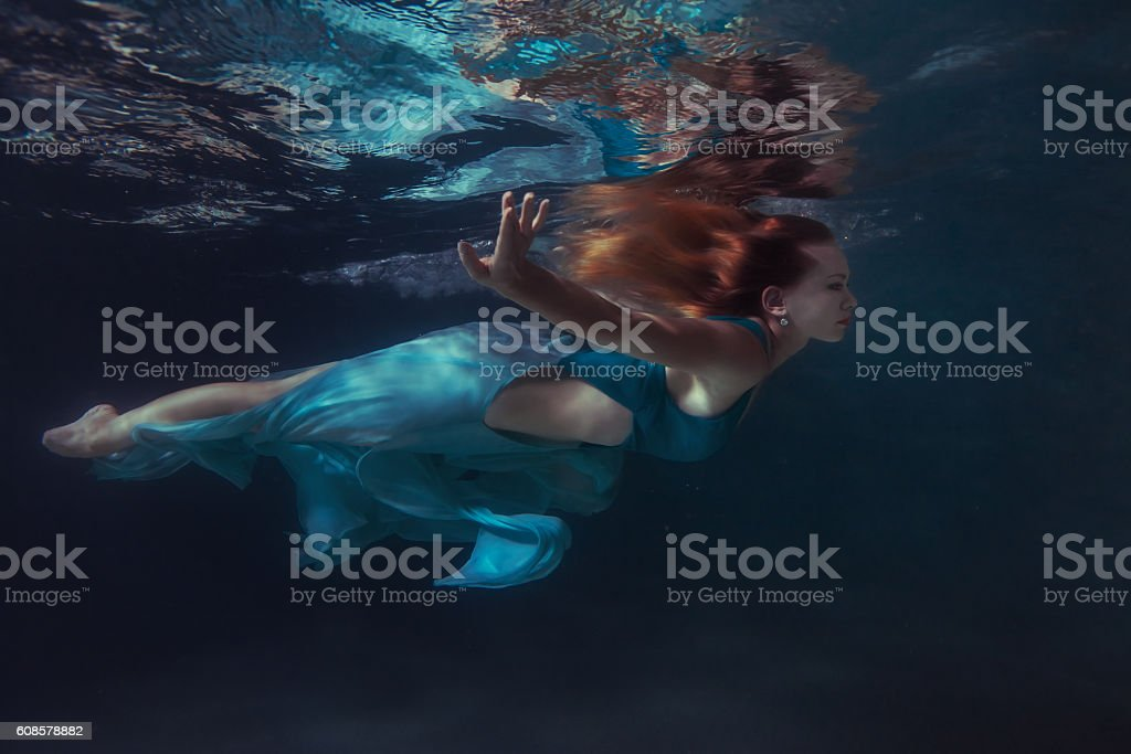 Woman in a dress floats. stock photo