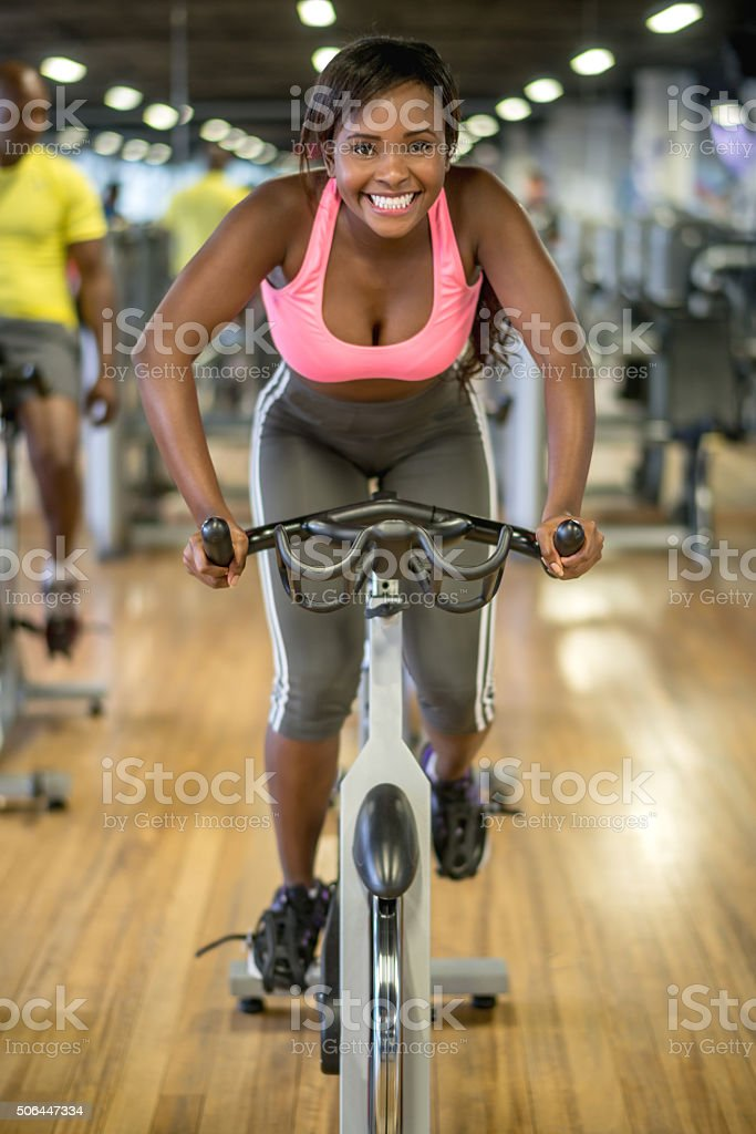 Woman in a spinning class at the gym stock photo