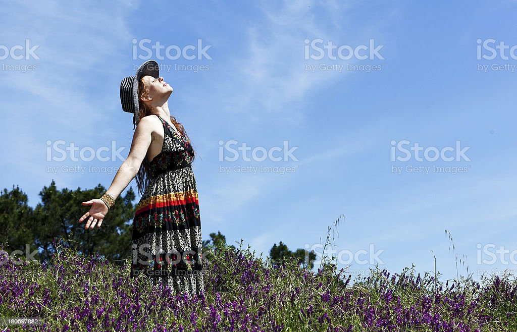 woman in a field of wildflowers royalty-free stock photo