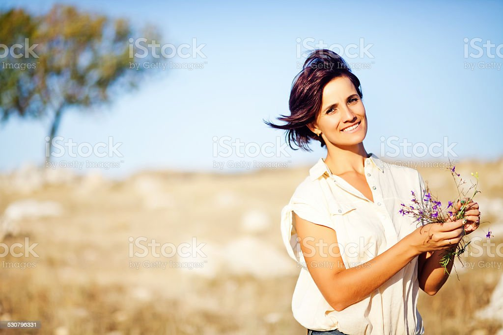 Woman in a field stock photo