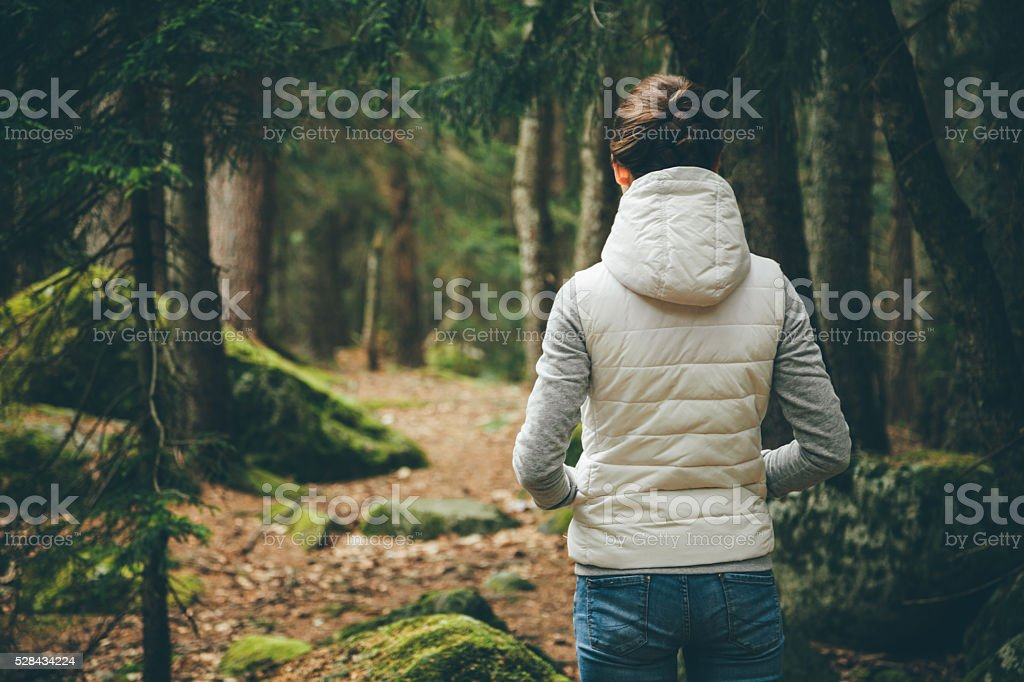 Woman in a forest stock photo