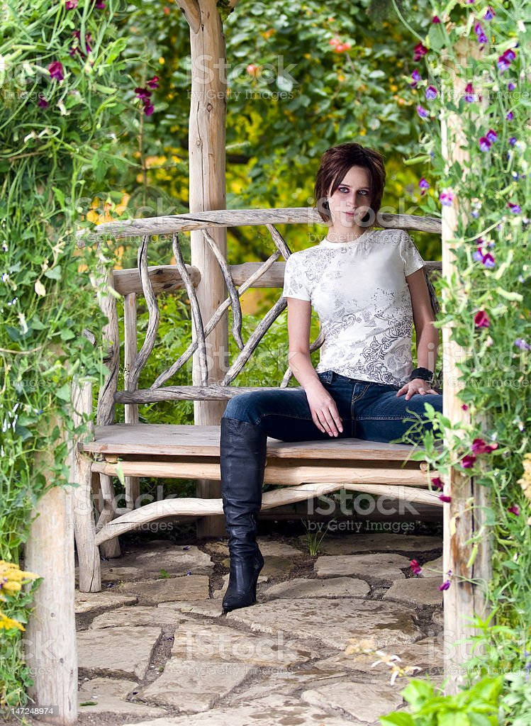 woman in a garden royalty-free stock photo