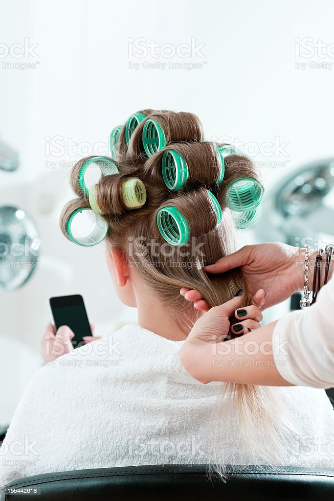 Woman in a hair salon royalty-free stock photo