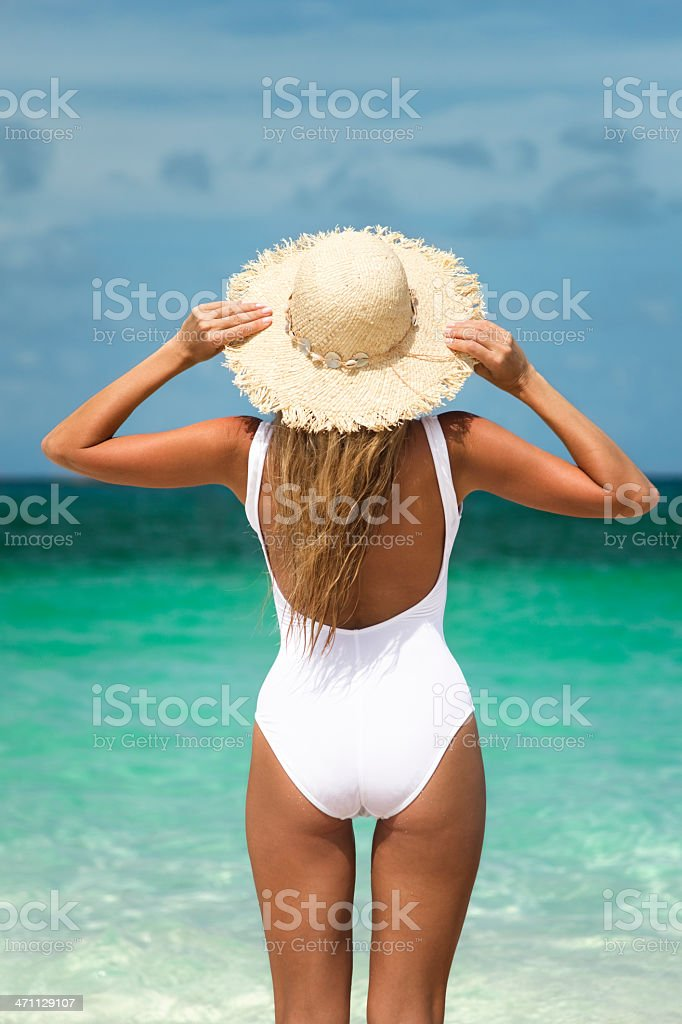 woman in a hat at the tropical beach royalty-free stock photo