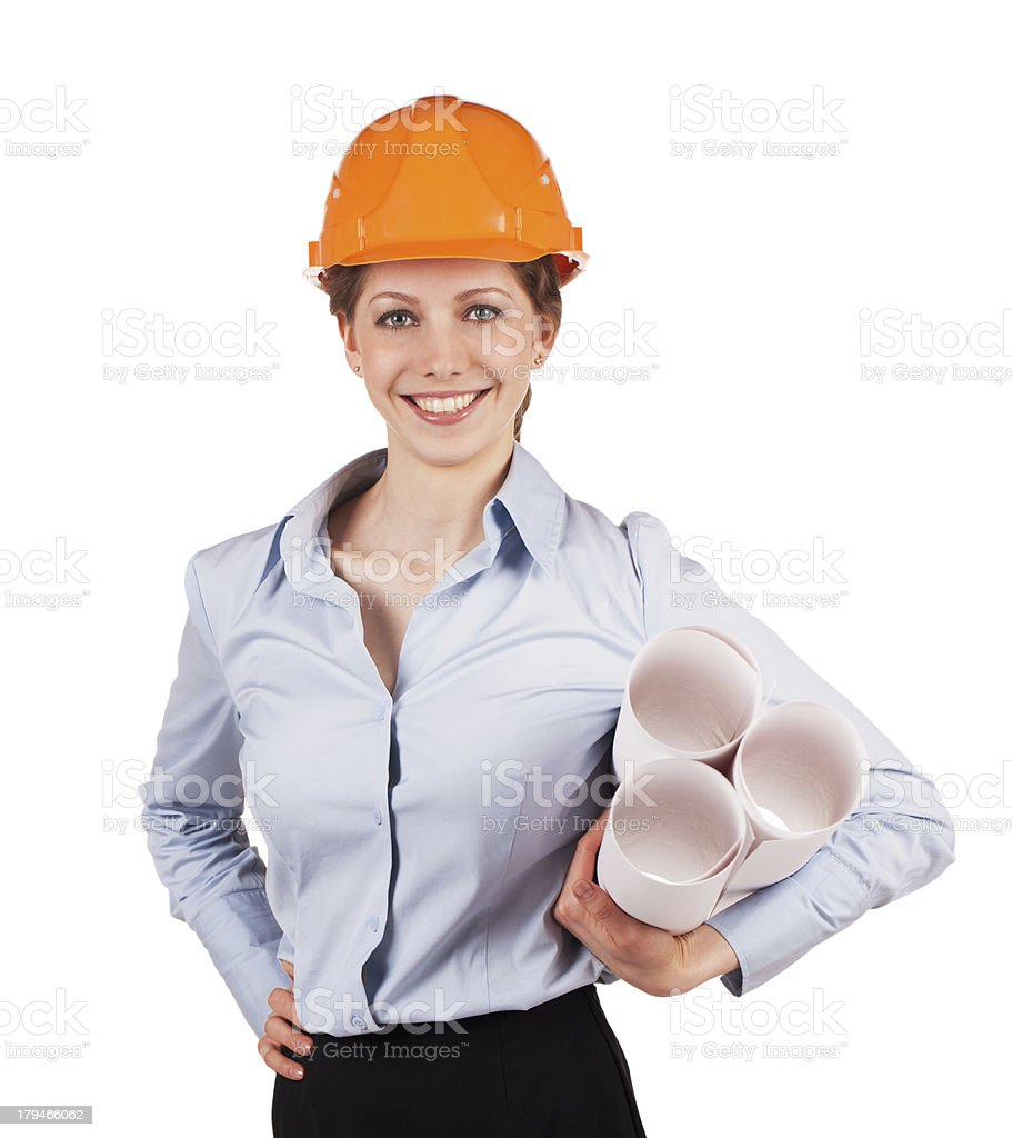 Woman in a helmet with construction plans royalty-free stock photo