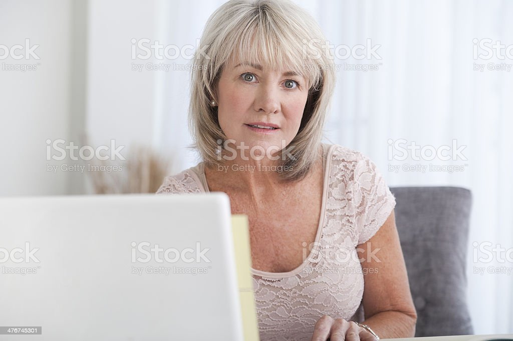 Woman in a home office royalty-free stock photo