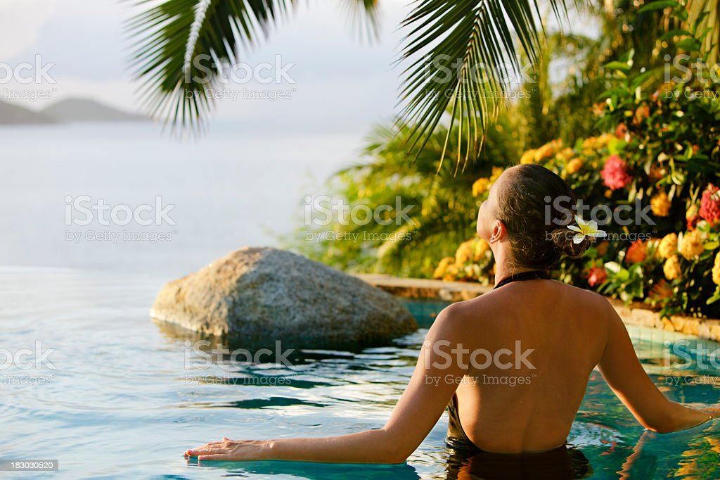 woman in a infinity pool jacuzzi at the Caribbean spa stock photo