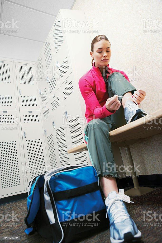 Woman in a locker room stock photo