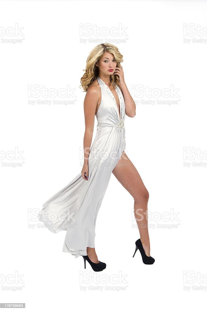 Woman in a Long Flowing Slit Gown with High Heels stock photo