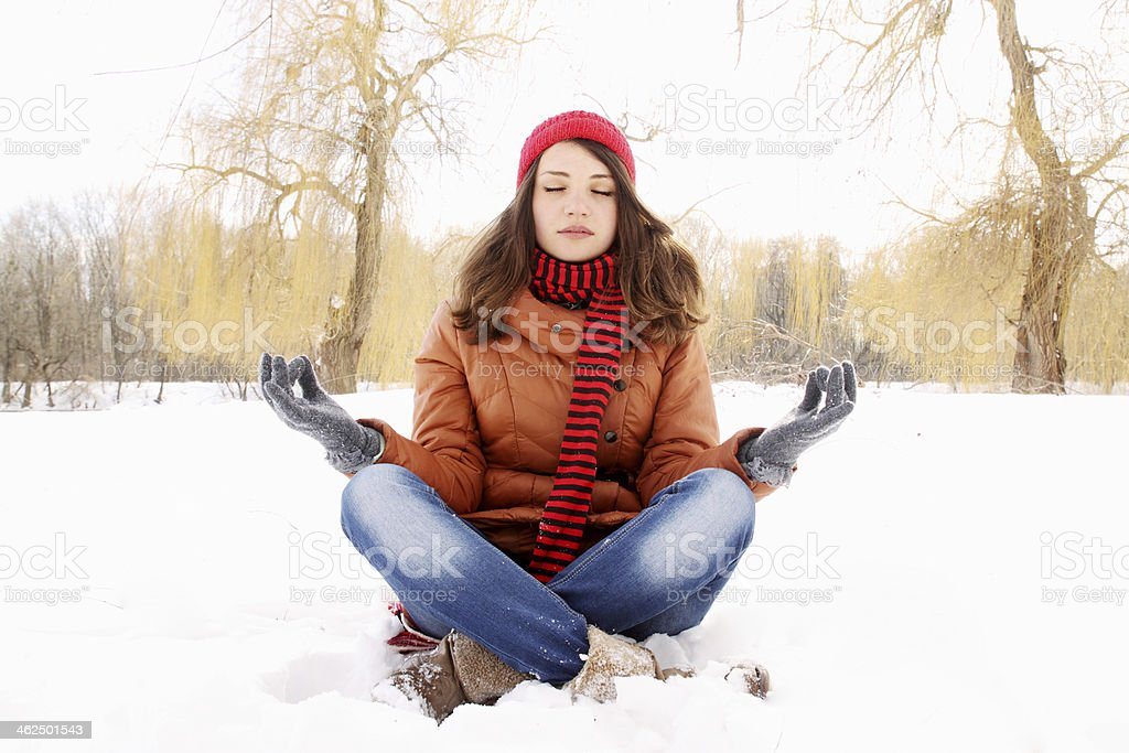 woman in a lotus position stock photo