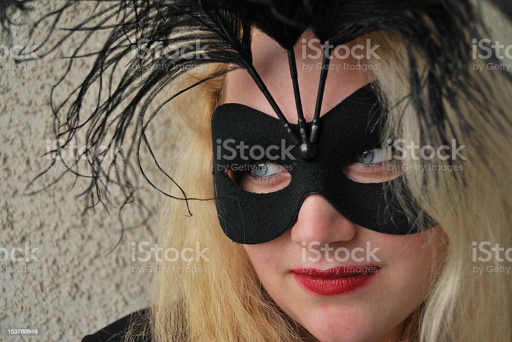 Woman in a mask stock photo