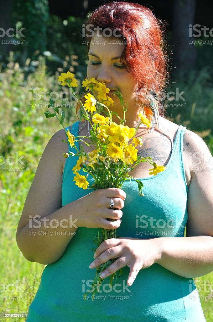Woman in a meadow stock photo