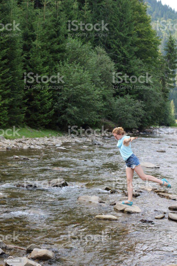 Woman in a mountain`s river. stock photo